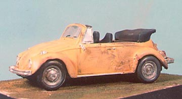 The same 1/25th scale Volkswagen Cabriolet, showing weathering on the left side. Besides the use of Marmo's Magic Dust, note the useless outside rear view mirror and the single dented hubcap.
